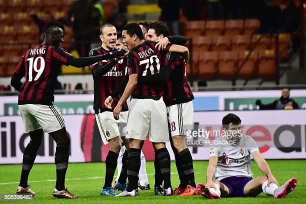 AC Milan's Colombian forward Carlos Bacca celebrates with teammates after scoring a goal during the Serie A football match between AC Milan and...