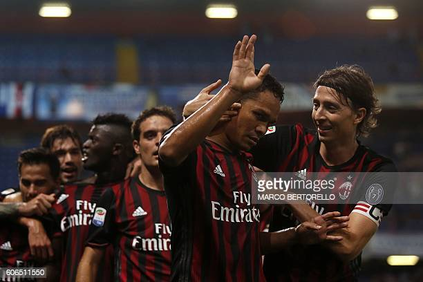 AC Milan's Colombian forward Carlos Bacca celebrates with teammates after scoring during the Italian Serie A football match between Sampdoria and AC...