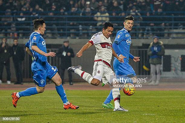 AC Milan's Colombian forward Carlos Bacca shoots to score during the Italian Serie A football match Empoli vs AC Milan on January 23 2016 at Empoli's...