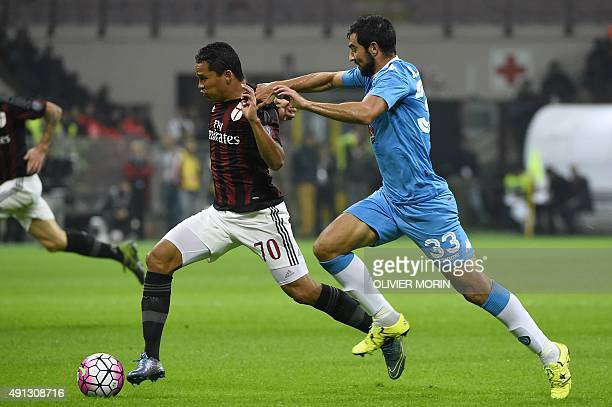 AC Milan's Colombian forward Carlos Bacca vies for the ball with Napoli's Spanish defender Raul Albiol during the Italian Serie A football match...
