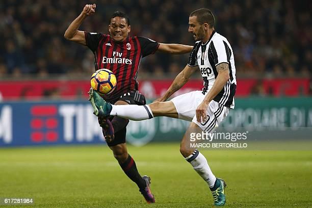 AC Milan's Colombian forward Carlos Bacca vies with Juventus' defender Leonardo Bonucci during the Italian Serie A football match AC Milan versus...