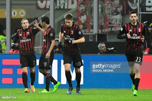 AC Milan's Colombian forward Carlos Vacca congratulates AC Milan's Spanish forward Gerard Deulofeu after he scored the second goal during the Italian...