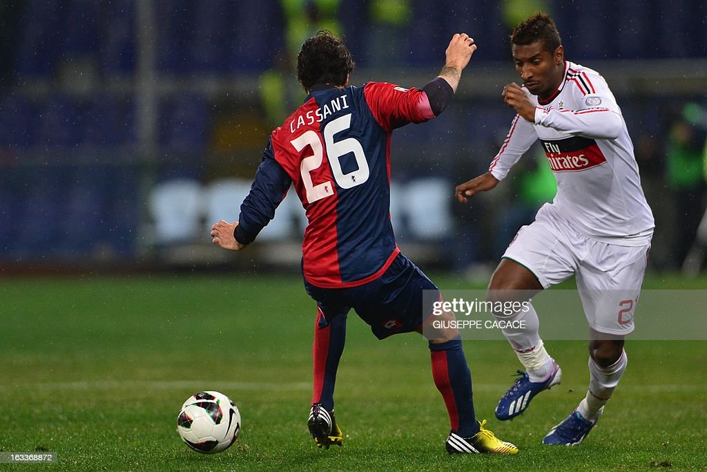 AC Milan's Colombian midfielder Kevin Constant (R) vies with Genoa's defender Mattia Cassani during the Italian championships Serie A football match Genoa vs AC Milan at the Marazzi Stadium in Genova on March 8, 2013.