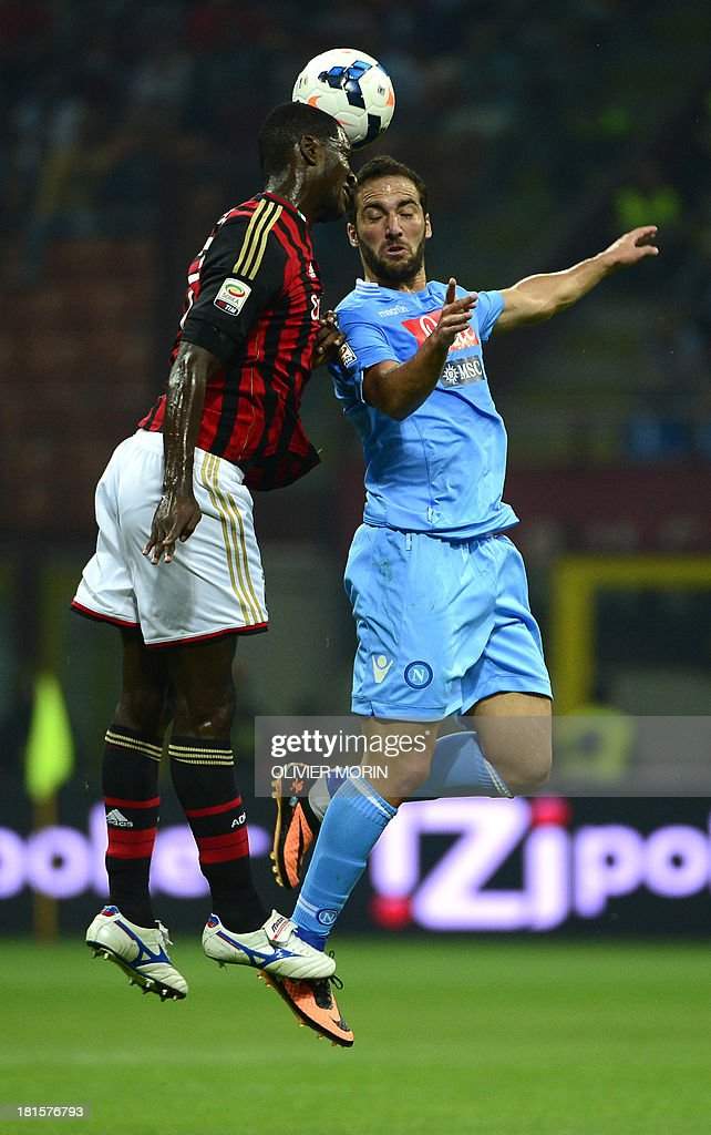 AC Milan's Columbian defender Cristian Zapata (L) fights for the ball with Napoli's Argentinian forward Gonzalo Gerardo Higuain during the seria A football match AC Milan vs Naples, on septembre 22, 2013, in San Siro stadium in Milan.