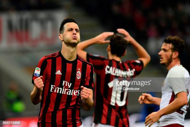 AC Milan's Craotian forward Nikola Kalinic and AC Milan's German midfielder Hakan Calhanoglu react during the Italian Serie A football match AC Milan...