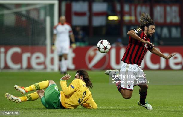 AC Milan's Cristian Zaccardo is felled by Celtic's Giorgos Samaras during the UEFA Champions League Group H match between AC Milan and Glasgow Celtic...