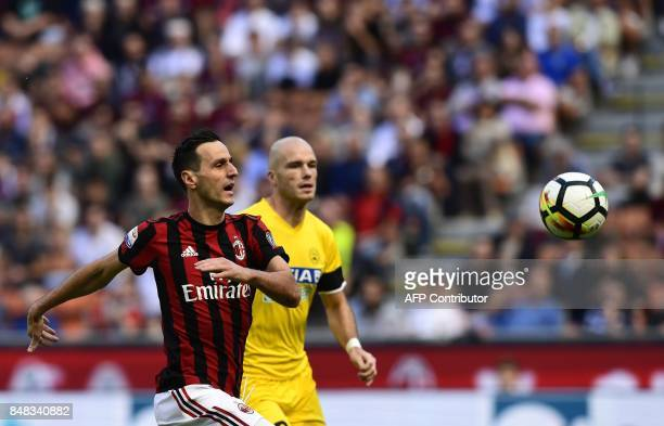 AC Milan's Croatian forward Nikola Kalinic fights for the ball with Udinese's Dutch defender Bram Nuytinck during the Italian Serie A football match...