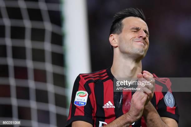 AC Milan's Croatian forward Nikola Kalinic reacts during the Italian Serie A football match AC Milan vs Spal at San Siro stadium in Milan on...