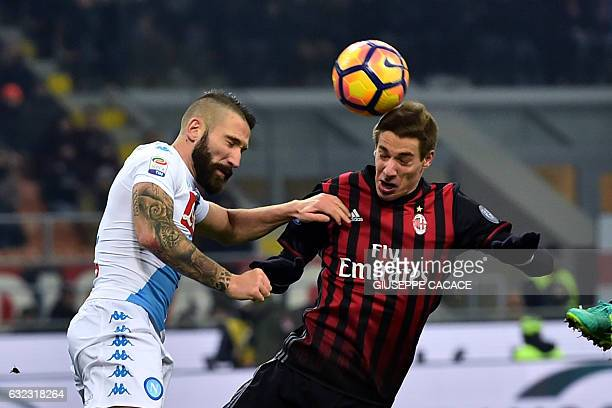 AC Milan's Croatian midfielder Mario Pasalic fights for the ball with Napoli's Italiqn defender Lorenzo Tonelli during the Italian Serie A football...