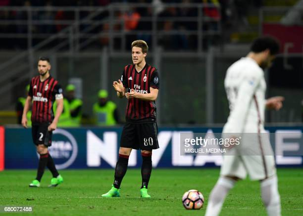 AC Milan's Croatian midfielder Mario Pasalic reacts after scoring during the Italian Serie A football match AC Milan vs AS Roma at the San Siro...