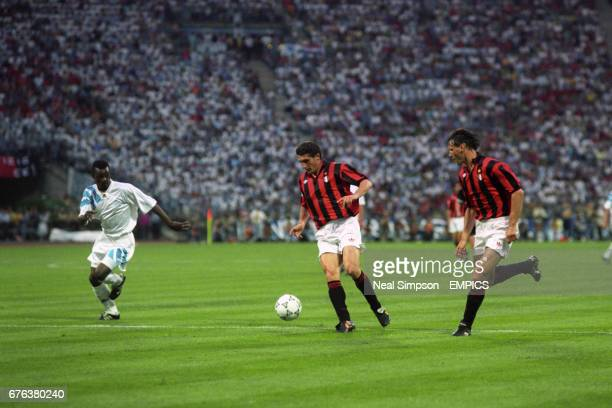 AC Milan's Daniele Massaro in action with teammate Marco van Basten watched by Marseille's Jocelyn Angloma