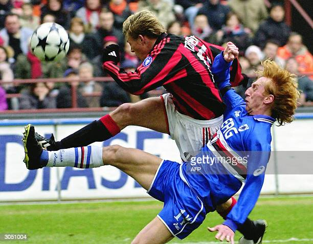 Milan's Danish forward John Dakl Tomasson fights for the ball with a Sampdoria Genoa defender during their Serie A football match at San Siro stadium...