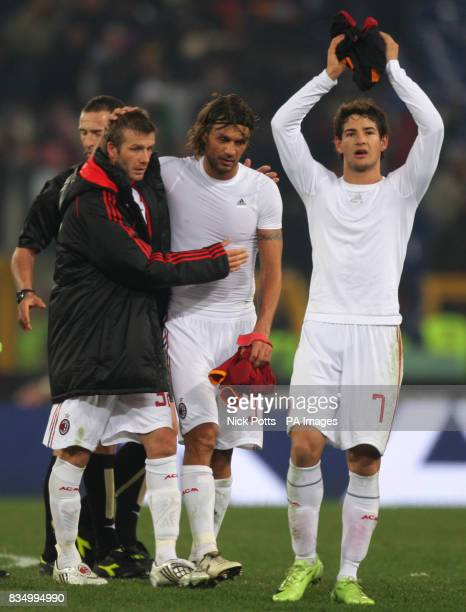 AC Milan's David Beckham hugs captain Paulo Maldini as double goalscorer Alexandre Pato thanks the fans after 22 draw against Roma at the Olympic...