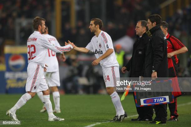 AC Milan's David Beckham is taken off on his debut after 87 minutes and is replaced by Mathieu Flamini during 22 draw against Roma at the Olympic...