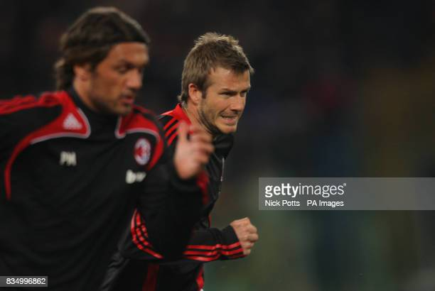 AC Milan's David Beckham warms up chasing after Paolo Maldini ahead of his debut against Roma