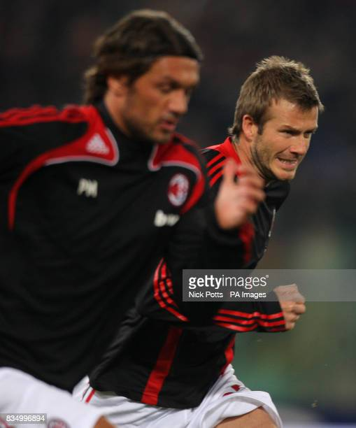 AC Milan's David Beckham warms up with Paolo Maldini