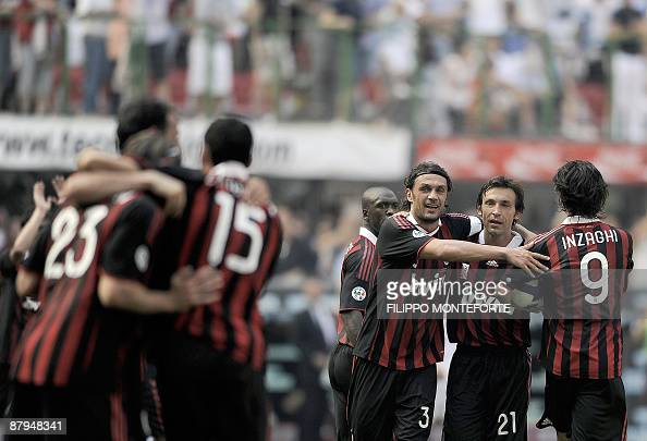 AC Milan's defender and captain Paolo Maldini celebrates with teamates after they scored a goal against AS Roma during their Serie A football match...