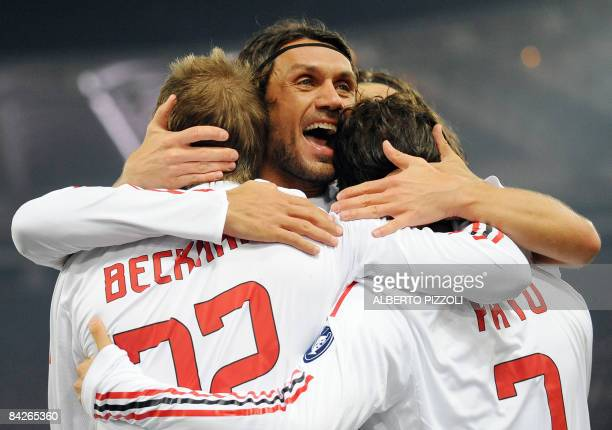 AC Milan's defender and captain Paolo Maldini English midfielder David Beckham and Brazilian forward Pato celebrate a goal by Pato against AS Roma...