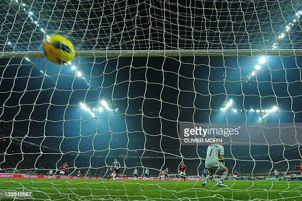 AC Milan's defender Antonio Nocerino shoots and scores past Juventus goalkeeper Gianluigi Buffon on February 25 2012 during a Serie A match at the...