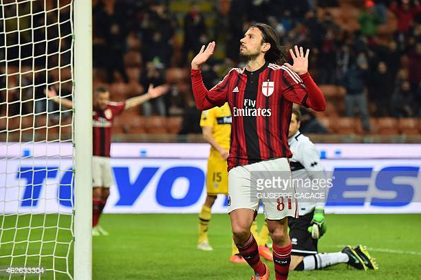 AC Milan's defender Cristian Zaccardo celebrates after scoring a goal during the Italian Serie A football match between AC Milan and Parma at San...