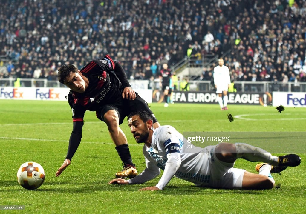 AC Milan's defender Davide Calabria (L) fights for the ball with Rijeka's midfielder Mate Males during the UEFA Europa League Group D football match between HNK Rijeka and AC Milan at The Rujevica Stadium in Rijeka on December 7, 2017. /