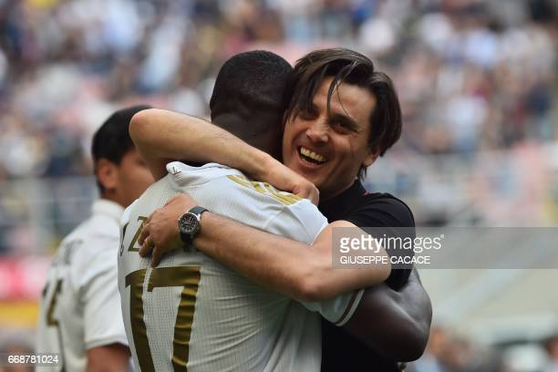 AC Milan's defender from Colombia Cristian Zapata celebrates with AC Milan's coach Vincenzo Montella after scoring a goal during the Italian Serie A...