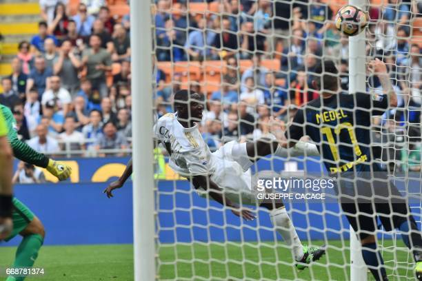 AC Milan's defender from Colombia Cristian Zapata scores during the Italian Serie A football match Inter Milan vs AC Milan at 'San Siro' Stadium in...