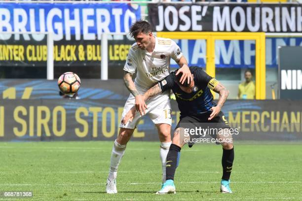AC Milan's defender from Italy Alessio Romagnoli fights for the ball with Inter Milan's forward from Argentina Mauro Icardi during the Italian Serie...