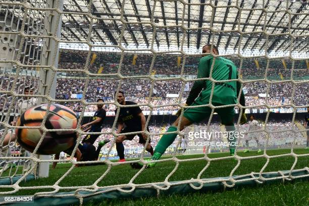 AC Milan's defender from Italy Alessio Romagnoli scores during the Italian Serie A football match Inter Milan vs AC Milan at 'San Siro' Stadium in...