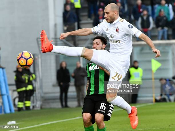 AC Milan's defender Gabriel Paletta controls the ball over Sassuolo's midfielder Matteo Politano during the Italian Serie A football match Sassuolo...