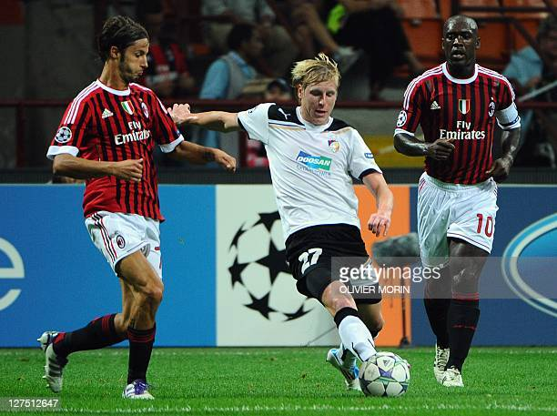 AC Milan's defender Luca Antonini fights for the ball with Viktoria Plzen's midfielder Frantisek Rajtoral during their Champions League matchday 2...
