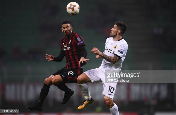 AC Milan's defender Mateo Musacchio from Argentina fights for the ball with AEK's forward Marko Livaja from Croatia during the UEFA Europa League...