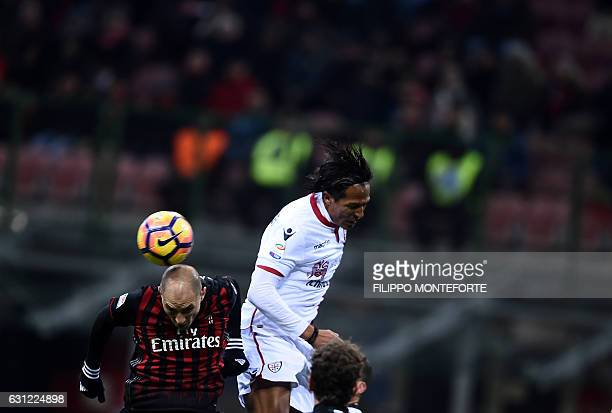 AC Milan's defender of Argentina Gabriel Paletta vies with Cagliari defender from Portugal Bruno Alves during the Italian Serie A football match AC...