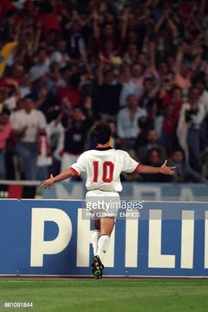 AC Milan's Dejan Savicevic celebrates scoring his team's third goal