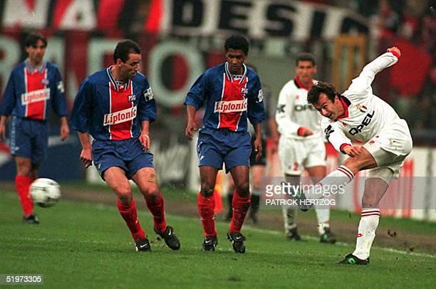 Milan's Dejan Savicevic kicks the ball past Paris SaintGermain's Paul Le Guen and Valdo during their Champions League second leg semifinal 19 April...