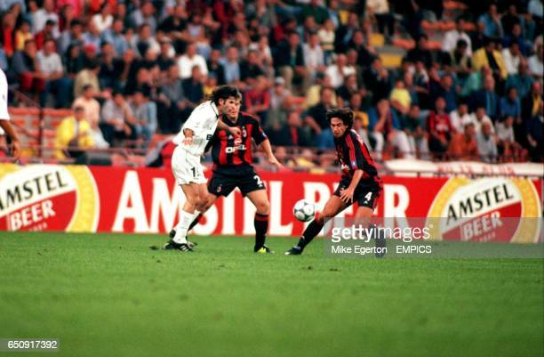 AC Milan's Demetrio Albertini and Thomas Helveg defend against Besiktas' Ibrahim Uzulmez