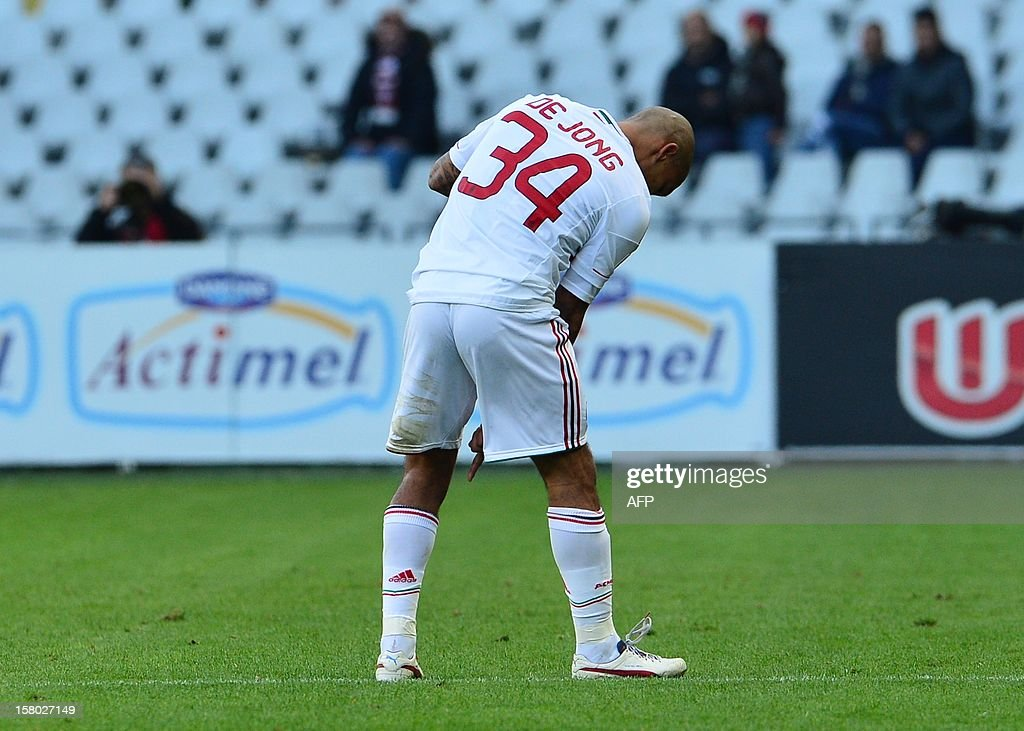 AC Milan's Dutch midfielder Nigel De Jong leaves the pitch as he suffers a ruptured Achilles tendon injury that will rule him out for the rest of the season during the Italian Serie A football match between Torino and AC Milan at the Olympic Stadium in Turin on December 9, 2012.