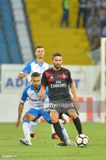AC Milan's Fabio Borini vs CSU Craiova's Radoslav Dimitrov during CSU Craiova v AC Milan UEFA Europa League 2017/2018 Third Qualifying Round in...