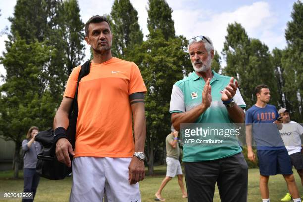 AC Milan's former player Paolo Maldini arrives for the men's doubles tennis match with his partner Stefano Landonio against Poland's player Tomasz...