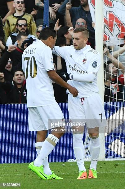 AC Milan's forward Carlos Bacca celebrates with AC Milan's defender Gerard Deulofeu after scoring a goal during the Italian Serie A football match...