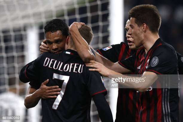 AC Milan's forward Carlos Bacca from Colombia celebrates after scoring with AC Milan's midfielder Gerard Deulofeu from France during the Italian...