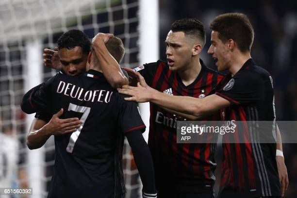 AC Milan's forward Carlos Bacca from Colombia celebrates with teammates after scoring during the Italian Serie A football match Juventus Vs AC Milan...