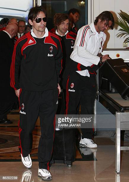 AC Milan's forward Filippo Inzaghi wheels his suitcase upon his arrival to the airport in the Qatari capital of Doha on March 3 2009 The Rossoneri...