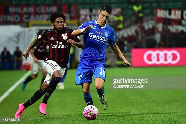 AC Milan's forward from Brazil Luiz Adriano fights for the ball with Empoli's defender from Italy Federico Barba during the Italian Serie A football...