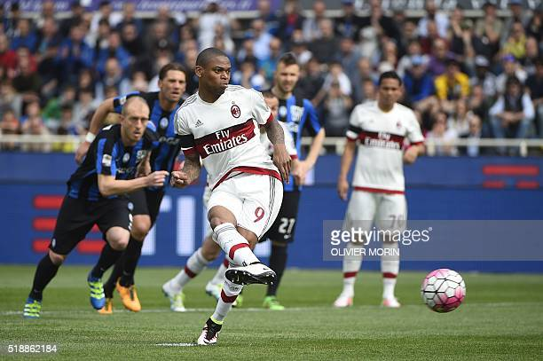 AC Milan's forward from Brazil Luiz Adriano scores a penalty kick during the Italian Serie A football match Atalanta vs AC Milanon on April 3 2016 at...