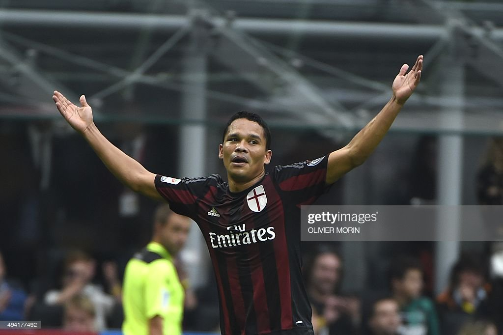 AC Milan's forward from Colombia Carlos Bacca celebrates after scoring a penalty during the Italian Serie A football match AC Milan vs Sassuolo on...