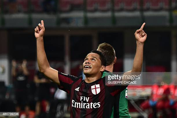 AC Milan's forward from Colombia Carlos Bacca celebrates after scoring against Empoli's goalkeeper from Poland Lukasz Skorupski during the Italian...