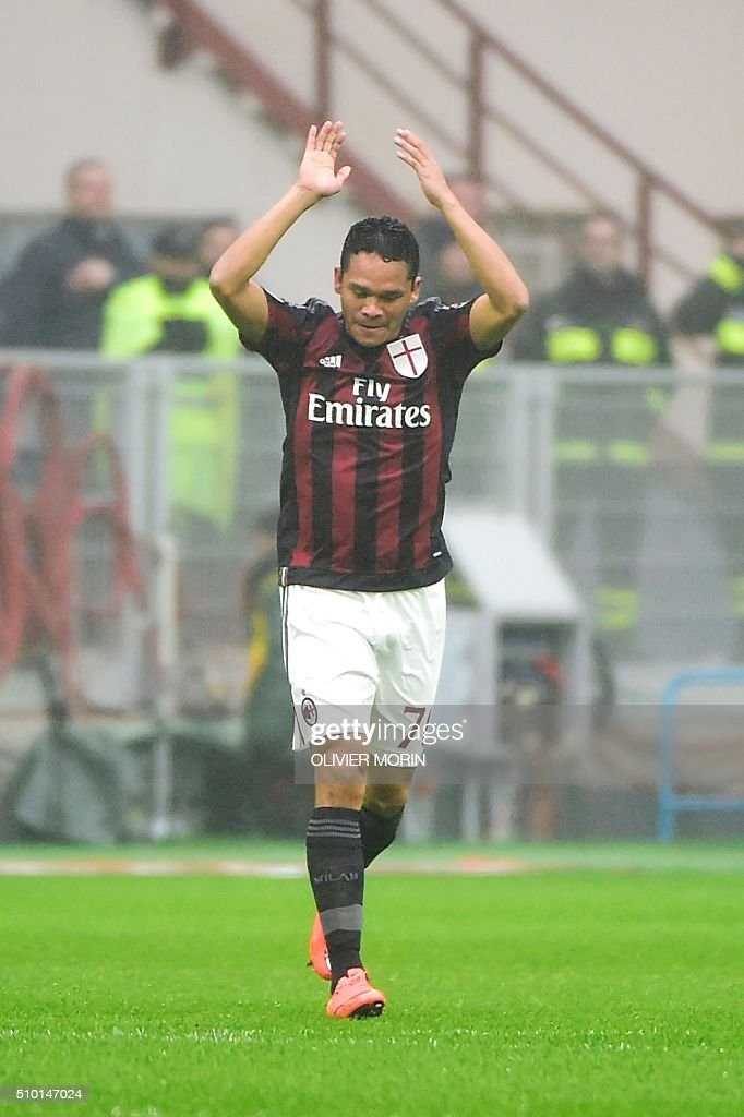 AC Milan's forward from Colombia Carlos Bacca celebrates after scoring during the Italian Serie A football match AC Milan vs Genoa on February 14, 2016 at the San Siro Stadium stadium in Milan. MORIN