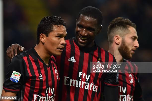 AC Milan's forward from Colombia Carlos Bacca celebrates with teammates AC Milan's defender from Colombia Cristian Zapata and AC Milan's midfielder...