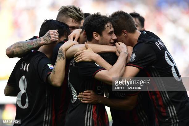 AC Milan's forward from Colombia Carlos Bacca celebrates with teammates after scoring during the Italian Serie A football match AC Milan vs Palermo...